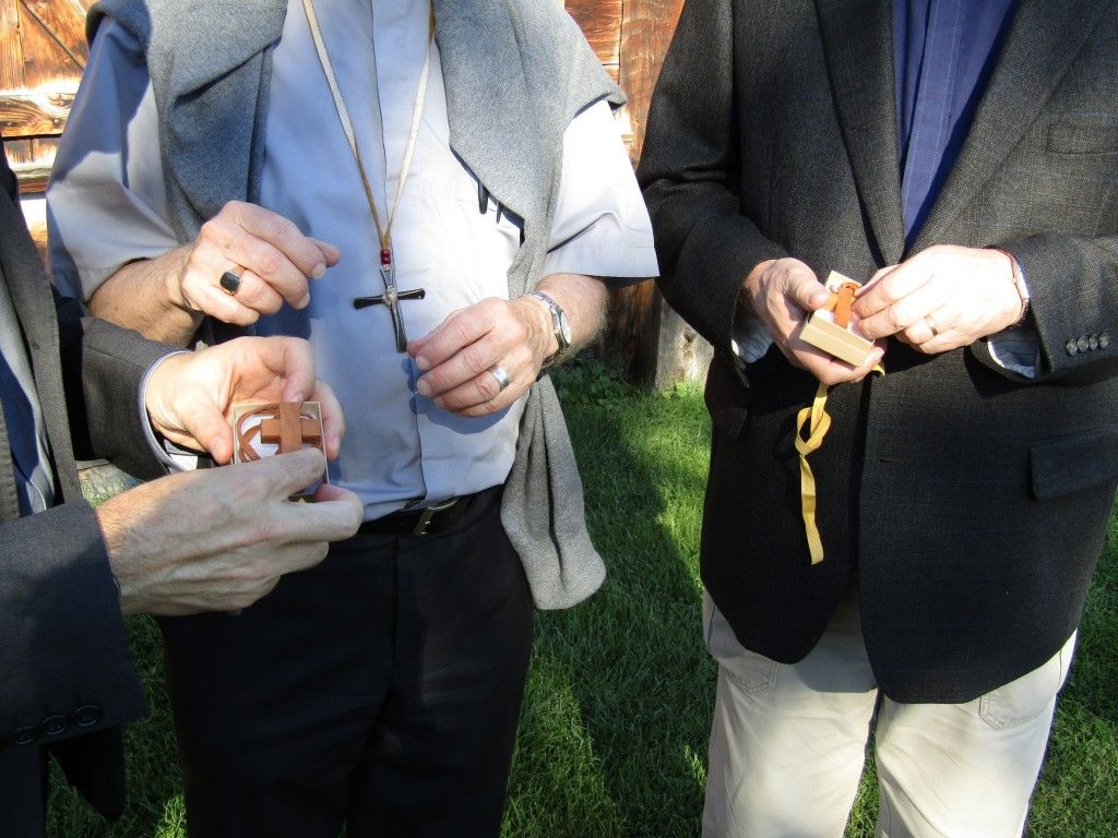 Father Bernard Carroll, S.J. presents Father Peter Bisson, S.J. and Father Jean-Marc Biron, S.J. with crosses made from a cherry wood tree felled on Martyrs' Shrine property. Presentation of the crosses at Sainte Marie Among the Hurons.