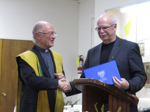 Tay Mayor Scott Warnock presents Fr. Bernie with a letter from the Township.