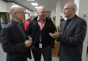Outgoing Martyrs`Shrine Director Fr. Bernie Carroll, S.J., Will Baird from Huronia Historical Parks and Tay Mayor Scott Warnock share a conversation at the Open House